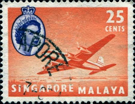 SINAGAPORE - CIRCA 1955  A stamp printed in Singapore shows Douglas DC-4M2, Argonaut, aircraft , circa 1955  Stock Photo - 17269478