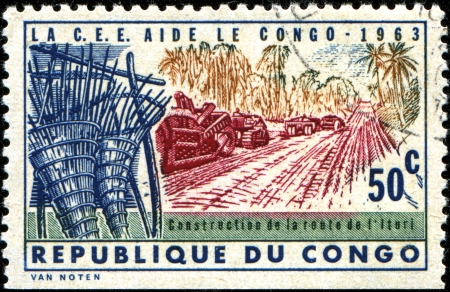 european economic community: CONGO - CIRCA 1963  A stamp printed in Congo  Kinshassa  shows Construction of Ituri Road, European Economic Community Aid, circa 1993
