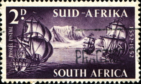 SOUTH AFRICA - CIRCA 1952  A stamp printed in South Africa shows arrival of Danish colonizers at Cape of Good Hope 1652, 300 anniversarycirca 1952  photo