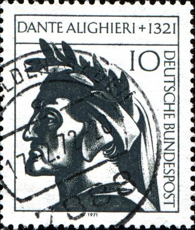 dante alighieri:  GERMANY - CIRCA 1971  A stamp printed in  Germany shows Dante Alighieri, Italian Poet, circa 1971  Stock Photo