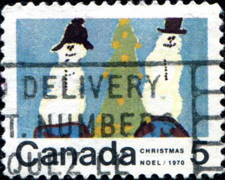 CANADA - CIRCA 1970  A stamp printed in Canada shows two showman and Christmas, circa 1970  photo