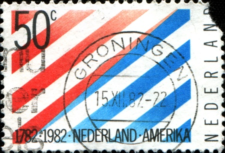 orange nassau:  USA - CIRCA 1982  A stamp printed in USA shows a picture of red and blue strips with the words of  1782 1982 USA -  Netherlands  at the bottom, circa 1982