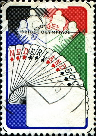 olympiad:  NETHERLANDS - CIRCA 1980  A stamp printed in  Netherlands shows Bridge Players, Netherlands Hand, 6th Bridge Olympiad, Valkenburg, circa 1980  Editorial