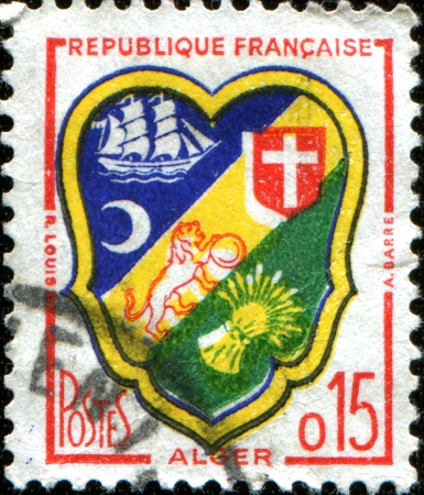 FRANCE - CIRCA 1958  A stamp printed in France  shows coat of arms of Algier, circa 1958 photo