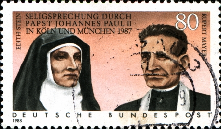 GERMANY - CIRCA 1988  A stamp printed in German Federal Republic shows Beatification of Edith Stein and Rupert Mayer by Pope John Paul II in 198, circa 1988 Stock Photo - 17950195