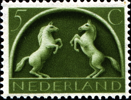 germanic: NETHERLANDS - CIRCA 1943  A stamp printed in  Netherlands shows Old Germanic Symbols - Prancing horses, circa 1943