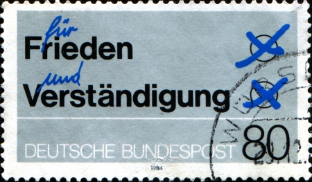 GERMANY - CIRCA 1984  A stamp printed in German Federal Republic shows  inscription peace and understanding, astronomer, circa 1984 photo
