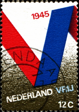 nederlan:  NETHERLANDS - CIRCA 1970  A stamp printed in Netherlands issued for the 25th anniversary of Liberation shows V Symbol, circa 1970  Stock Photo