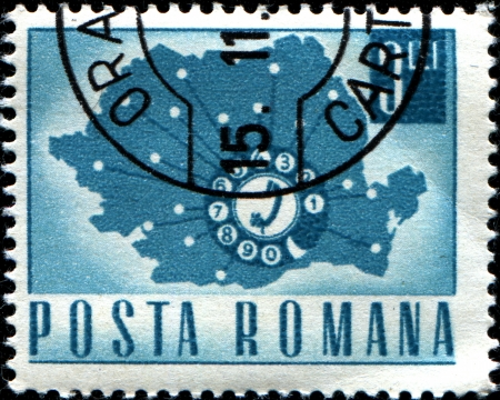 ROMANIA - CIRCA 1967  A stamp printed in Romania shows a Telephone Dial and Map of Romania, circa 1967 photo