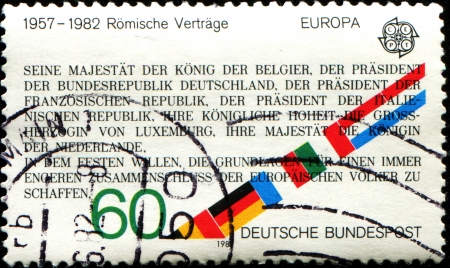 treaties: GERMANY - CIRCA 1982  A stamp printed in German Federal Republic shows Text from Treaties of Rome, 25th Anniversary, circa 1982