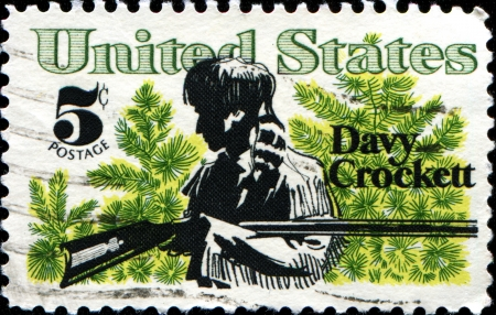 congressman: USA - CIRCA 1967  A stamp printed in  United States of America shows Davy Crockett frontiersman and congressman who died in defense of the Alamo, circa 1967