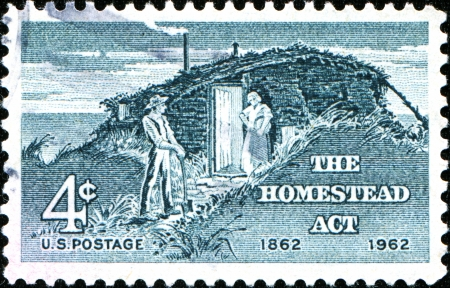 homestead: USA - CIRCA 1962: A stamp printed in the United States of America shows Sod Hut and Settlers, from the series Homestead Act Centenary, circa 1962 Editorial