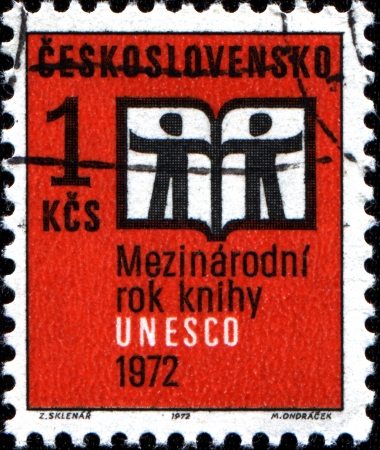 CZECHOSLOVAKIA - CIRCA 1972  A stamp printed in Czechoslovakia showing an open book with silhouette of two man to commemorate UNESCO International Year Book, circa 1972 Stock Photo - 18798515