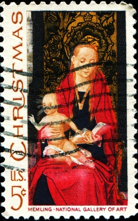 memling: USA -CIRCA 1966  A stamp printed in USA shows the picture of the Virgin Mary and baby Jesus in her lap  The original image was from mid 1488-1490 - a painting named Madonna and Child  Circa 1966  Editorial