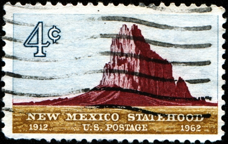 statehood: USA - CIRCA 1962  A stamp printed in the United States of America issued for the 50th anniversary of Statehood of New Mexico shows Shiprock, circa 1962