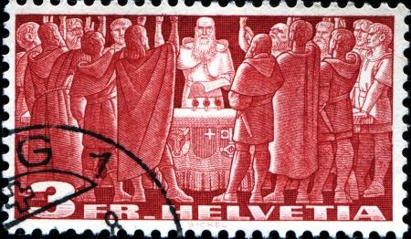 privileged: SWITZERLAND - CIRCA 1938  A stamp printed in Switzerland shows Citizens Voting, circa 1938