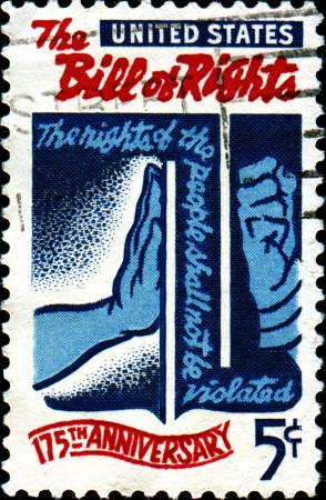 bill of rights: USA - CIRCA 1966  A stamp printed in the United States of America shows Freedom checking Tyranny, devoted to Bill of Rights, 175th Anniversary, circa 1966