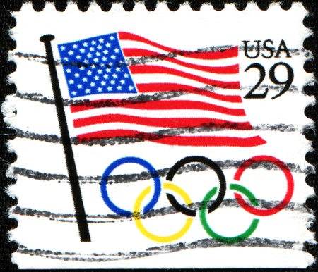 usps: UNITED STATES OF AMERICA - CIRCA 1991  A stamp printed in the United States of America shows Flag and Olympic rings, circa 1991