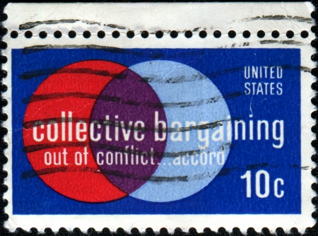 collective bargaining: USA - CIRCA 1975  A stamp printed in United States of America depics Labor and management  Collective bargaining law was enacted in 1935, in the Wagner Act, circa 1975 Editorial