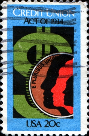 credit union: USA - CIRCA 1984  A stamp printed in United States of America shows Profiles and the dollar sign Credit Union, circa 1984