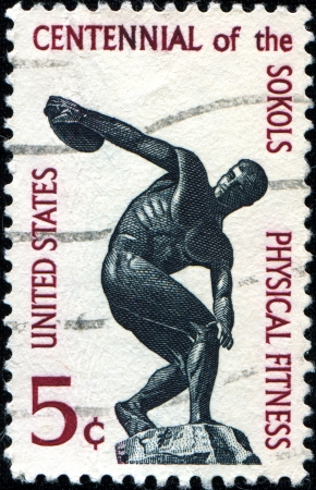 USA - CIRCA 1965  A stamp printed in United States of America shows discus trowler, Centennial of Sokols, Physical Fitness, circa 1965 Stock Photo - 18798745