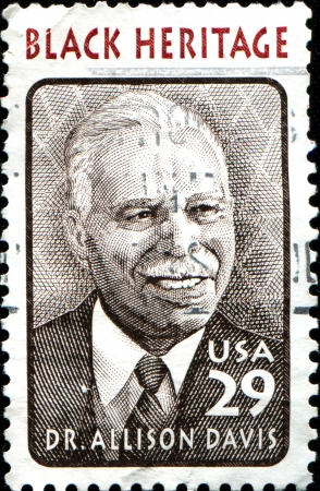 anthropologist: USA - CIRCA 1994: A stamp printed in United States of America shows Dr. Allison Davis, educator and anthropologist, circa 1994  Editorial
