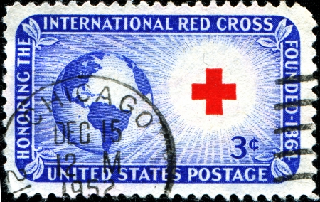 honoring: USA - CIRCA 19  A stamp printed in United States of America shows Globe, Sun and Red Cross  Honoring the International Red Cross Founded 1864, circa 1952