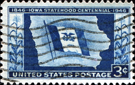 statehood: USA - CIRCA 19  A stamp printed in United States of America shows Map of state with flag, with inscription Iowa Statehood Centennial,  circa 1946