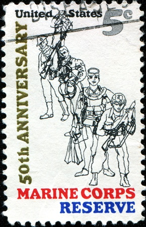 flier: USA - CIRCA 1966: A stamp printed in United States of America shows Combat Marine, 1966; Frogman; WW II Flier; WW I Devil Dog and Marine, 1775, 50th anniversary of the founding of U.S. Marine Corps Reserve, circa 1966  Editorial