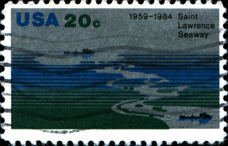 shipway: USA - CIRCA 1984  A stamp printed in United States of America shows aerial view of Seaway, Freighters, 25th Anniversary of Saint Lawrence Seaway, circa 1984  Editorial