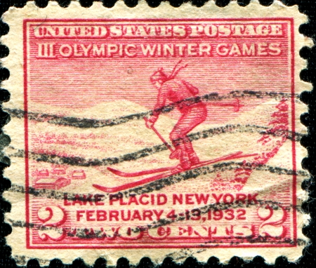 olympiad: USA - CIRCA 1932  A stamp printed in United States of America shows skier, III Winter Olympic Games,  Lake Placid - New York, February, 1932