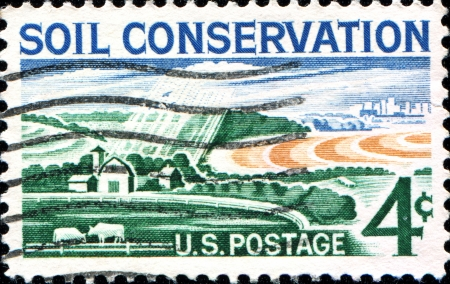 soil conservation: USA - CIRCA 1959  A stamp printed in United States of America shows Modern Farm, Soil Conservation, circa 1959  Editorial