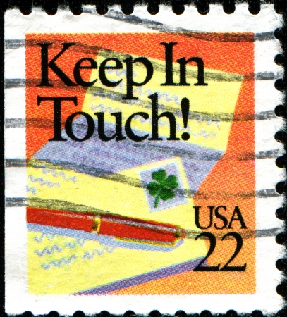 keep in touch: USA - CIRCA 1987  A stamp printed in United States of America shows Holidays of every faith have their cards, Keep in Touch , circa 1987