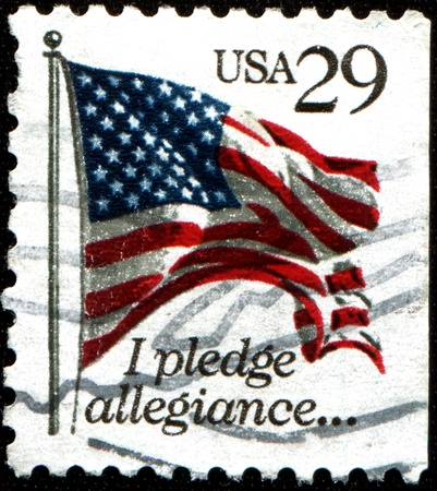 allegiance: USA - CIRCA 1992  A stamp printed in United States of America shows  USA Flag, I Pledge of Allegiance, circa 1992