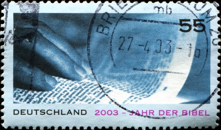GERMANY - CIRCA 2003  A stamp printed in German Federal Republic issued for Year of the Bible,  showsHand and Page, circa 2003