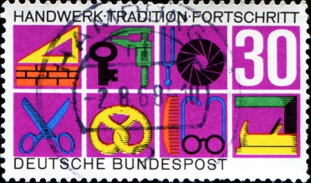 GERMANY - CIRCA 1968  A stamp printed in German Federal Republic dediceted  German Crafts and Trades, shows Trade Symbols, circa 1968 Stock Photo - 18798740