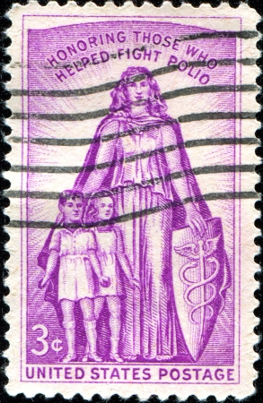 paralysis: USA - CIRCA 19  A stamp printed in United States of America shows childrens and woman,  Those who helped fight polio , 20th anniv  of the National Foundation for Infantile Paralysis, circa 1957