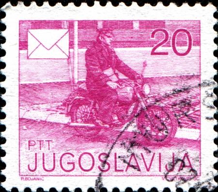 yugoslavia: YUGOSLAVIA - CIRCA 1986  Stamp printed in Yugoslavia shows postman on bike, circa 1986