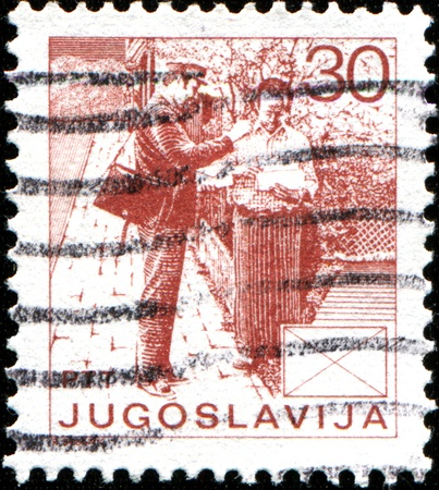 yugoslavia: YUGOSLAVIA - CIRCA 1986  Stamp printed in Yugoslavia shows  Postman giving letters to man, circa 1986