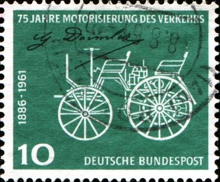 daimler: GERMANY - CIRCA 1961  A stamp printed in German Federal Republic honoring 75th Anniv of Daimler-Benz Patent, shows Early Daimler Motor Car, circa 1961