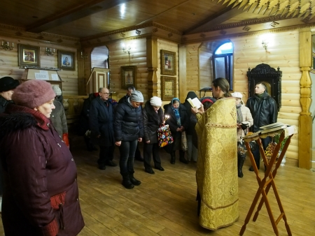 Ukraine, Lugansk - January 7, 2014 Orthodox Christians from Lugansk celebrated Christmas in the Baptistary of the Our Lady of Tenderness temple  Priests carry out a Christmas public prayer