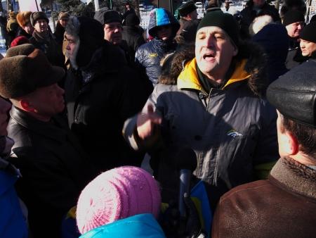 lugansk: LUGANSK, UKRAINE - JANUARY 26, 2014: Man tries to provoke the opposition rally