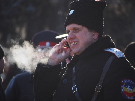 LUGANSK, UKRAINE - JANUARY 26, 2014: People in paramilitary uniforms who call themselves Cossacks gathered near the building of the State Administration of Lugansk.