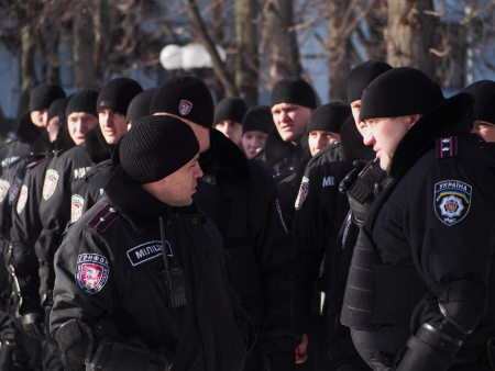 police unit: LUGANSK, UKRAINE - JANUARY 25, 2014: Squad Gryphon at an opposition rally.  A special unit of the judicial police of MIA of Ukraine Gryphonmust ensure safety of employees in high profile court cases, their families and relatives, as well as participan Editorial