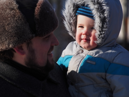 LUGANSK, UKRAINE - JANUARY 26, 2014: pasrticipant of ralli with child. Despite the laws adopted by the Verkhovna Rada of Ukraine, in violation of the procedure January 16, 2014, activists come to protest.