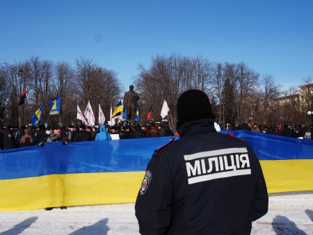 despite: LUGANSK, UKRAINE - JANUARY 26, 2014: activists unfurled a 27-meter flag of Ukraine. Despite the laws adopted by the Verkhovna Rada of Ukraine, in violation of the procedure January 16, 2014, activists come to protest.
