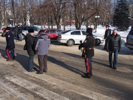 lugansk: LUGANSK, UKRAINE - JANUARY 26, 2014: People in paramilitary uniforms who call themselves Cossacks gathered near the building of the State Administration of Lugansk.
