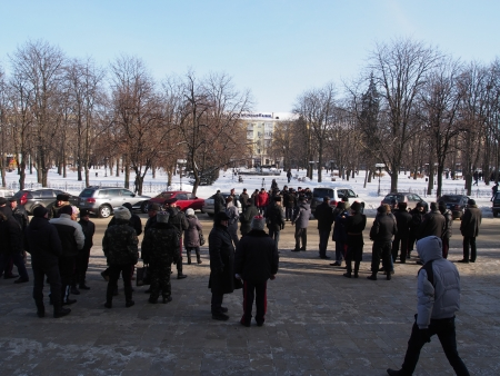 LUGANSK, UKRAINE - JANUARY 26, 2014: People in paramilitary uniforms who call themselves Cossacks gathered near the building of the State Administration of Lugansk. Police identify provocateurs among the opposition and does not allow of the rally.