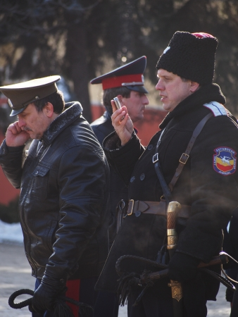 paramilitary: LUGANSK, UKRAINE - JANUARY 26, 2014: People in paramilitary uniforms who call themselves Cossacks gathered near the building of the State Administration of Lugansk. Police identify provocateurs among the opposition and does not allow of the rally.