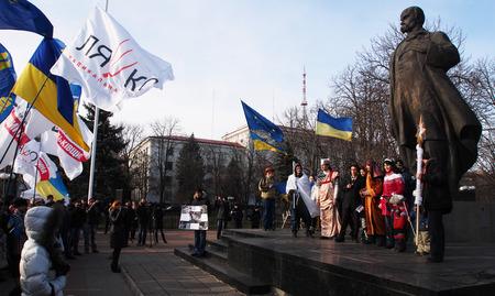lugansk: UKRAINE, LUGANSK - JANUARY 12, 2014  Opposition rally in the center of Lugansk near the monument of Ukranian poet Taras Shevchenko
